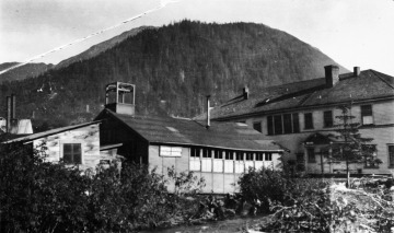 Black and white photograph of a Bureau of Indian Affairs school (on left) and U.S. Public Health Service hospital in Juneau, Alaska.