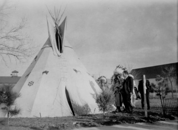 Bureau of Indian Affairs Commissioner John Collier and chiefs at tipi, 1934