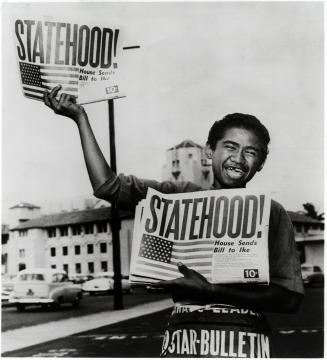 Hawaiian Holding Newspaper Announcing Statehood