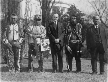President Calvin Coolidge with four Native Americans at the White House