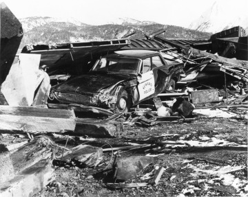 Seward squad car in a pile of wreckage following the tsunami generated by the 1964 earthquake