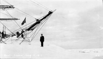 Artic Ocean, Emil Krulish standing outside ship in front of bow