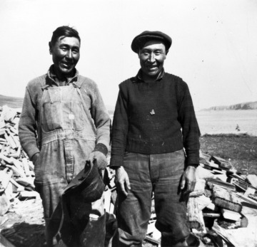 Evacuees Cornelias Kudrin, right and George Borenen, left from Kaskega village, Unalaska Island, 194