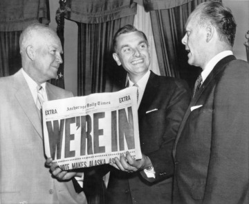 Men holding newspaper announcing Alaska Statehood