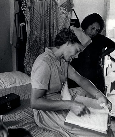 Health Aide Dorthy Press visits a migrant family in migrant workers' camp outside Nassawadox, Virginia, photograph by Janet Ochs for Public Health Service World, 1966